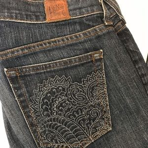 Lucky brand jeans with back pocket design, bootcut